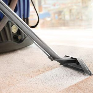 Commercial and office cleaners vacuuming